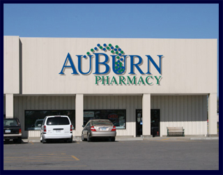 The AuBurn Pharmacy Garnett Location. The pharmacy is connected to Country Mart and has a large blue and green AuBurn Pharmacy Logo