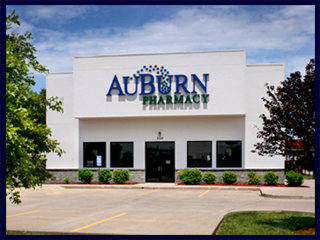 The AuBurn Pharmacy of Eudora, Kansas, is a large white building with a large blue and green AuBurn Pharmacy logo on the front.