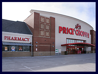Pictured is the Parkville Missouri Price Chopper. It is a tan building with bright red lettering